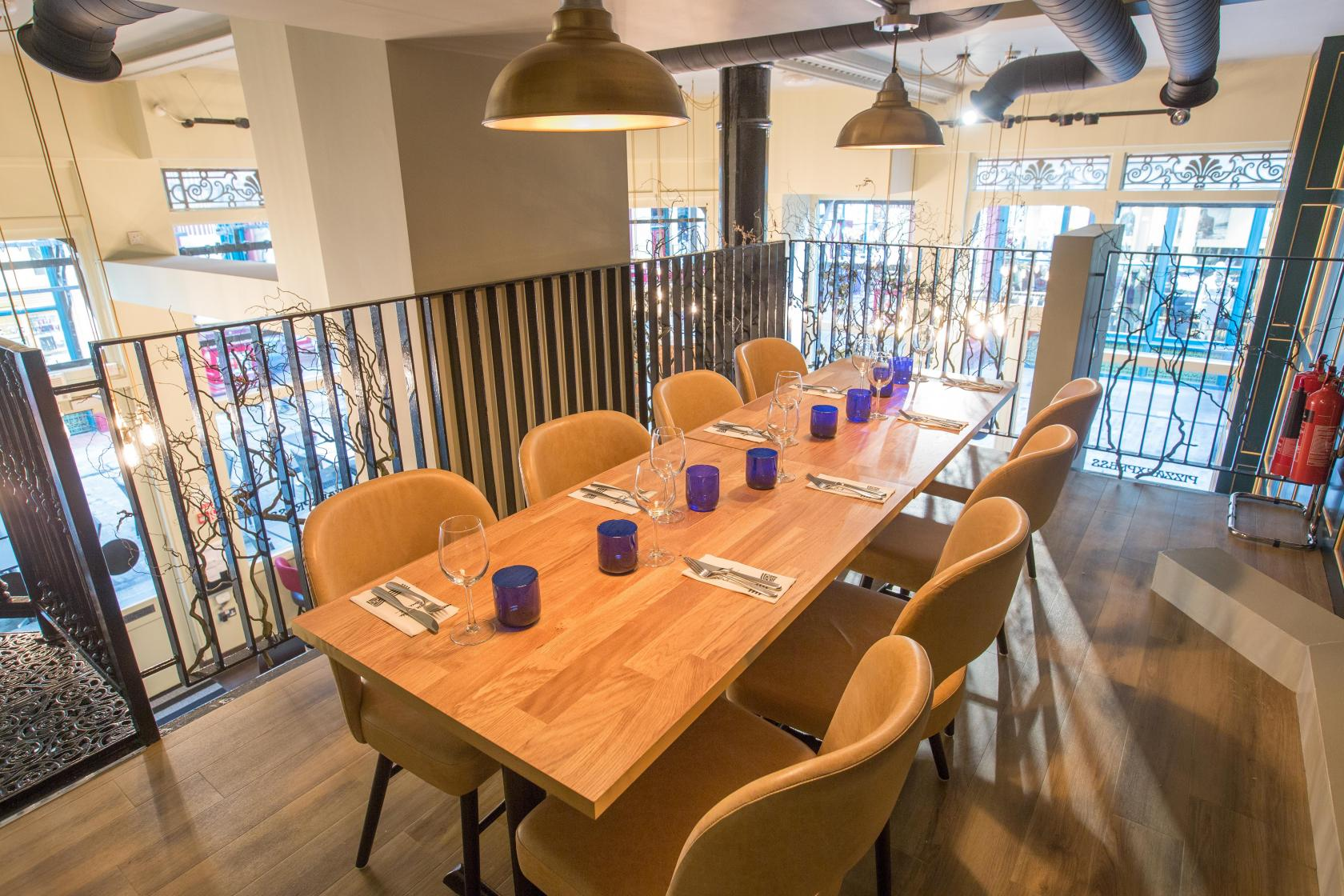 Book mezzanine semi private dining at pizzaexpress for Best private dining rooms central london